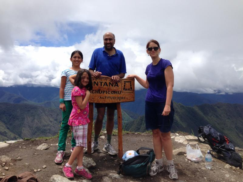 Professor Kathie Barnes, her husband (UA Economics Professor Gautam Gowrisankaran), and two of their three daughters at the top of Machu Picchu.